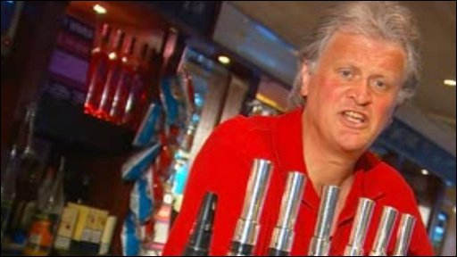Tim Martin at pub pump