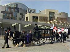 Mock funeral staged at Scottish Parliament