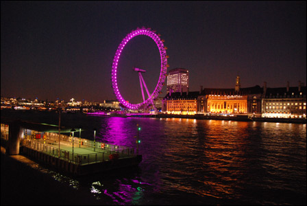 London Eye lit with purple lights