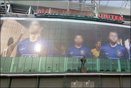 Players' billboard outside Old Trafford stadium in Manchester