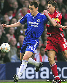Chelsea captain John Terry clears under pressure from his Liverpool counterpart Steven Gerrard in last year's Champions League semi-final