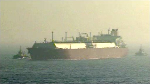 LNG Tanker escorted by two tug boat