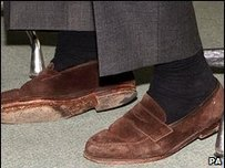 Ken Clarkes feet in a pair of suede shoes