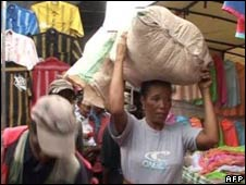 A Madagascan woman carries a bag. File photo