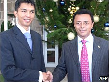 Pic from December 2007 of then newly-elected mayor Andry Rajoelina (l) and Marc Ravalomanana shaking hands
