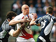 England's Mike Tindall takes on Max Evans and Chris Paterson