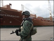 Venezuelan soldier patrols the sea port at Puerto Cabello, in Venezuela, on Saturday