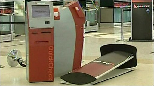 Interior of airport, equipment fallen over