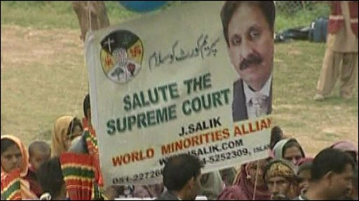 People holding up a banner showing an image of Iftikhar Chaudhry