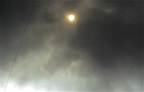 Sun seen through black smoke