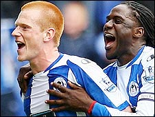 Wigan midfielder Ben Watson (left) celebrates with team-mate Mario Melchiot after his winner against Hull