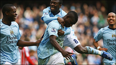 Micah Richards celebrates with his team-mates