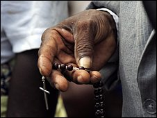 A man carries rosary beads