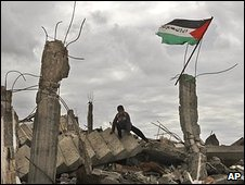 A boy on the rubble of a house in Jabaliya refugee camp destroyed in the Israeli military offensive in Gaza