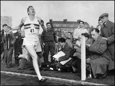 Sir Roger Bannister crosses the finishing line in 1954