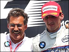 BMW F1 boss Mario Theissen and Robert Kubica on the podium after the Pole's victory in Canada last year
