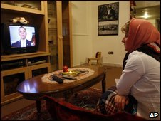 An Iranian woman watches President Obama's video message