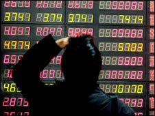 Trader looking at numbers on a board