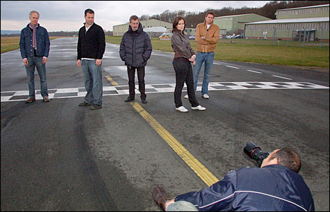 The BBC's F1 team pose for a photo on the Top Gear race-track