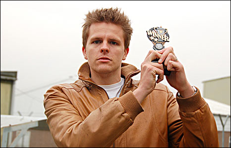 Jake raises his modest Top Gear 'winners' trophy