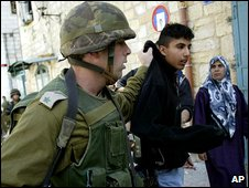 Israeli soldier leads away Palestinian suspect in Bethlehem (file picture)