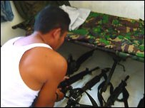 Indonesian soldier shows his guns