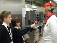 School Reporters interviewing an army chef