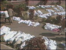 Dead bodies covered by shrouds (BBC)