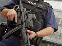 An armed police officer patrols Heathrow