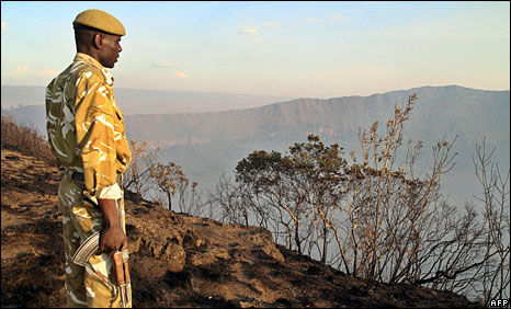 A Kenyan park ranger surveys a section of Mount Longonot national park in the Rift Valley, 22 March 2009