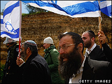 Right-wing Israeli Baruch Marzel leads a march with flags 24 march 2009 in Umm Al-Fahm