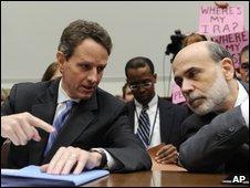 Treasury Secretary Timothy Geithner, left, talks with Federal Reserve Chairman Ben Bernanke