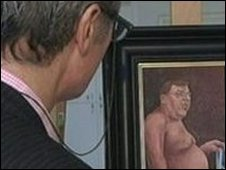 Image of man looking at painting