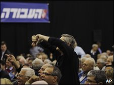 A Labour delegate shows his disapproval during Ehud Barak's speech, 24 March