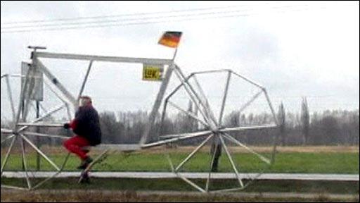 Man rides giant bicycle