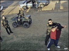 US Border Patrol agents in Laredo, Texas, detain an illegal immigrant (archive image)