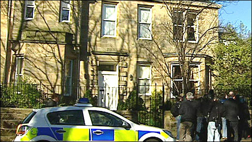 Police and press outside the home of Sir Fred Goodwin