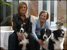 Anne Evans (daughter) with Barbara Evans and some of the family dogs