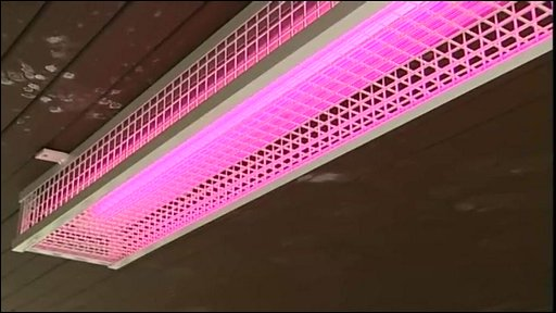 Pink neon light that shows up blemishes