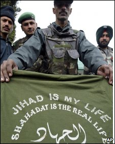 Indian soldier with the t-shirt of a slain militant