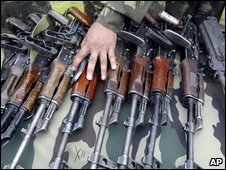 Army with captured militant arms in Indian-administered Kashmir