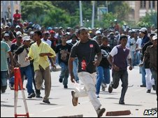 Supporters of ousted Madagascan President Marc Ravalomanana are dispersed by police during a march on 25 March 2009