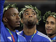 Darren Campbell (centre) wins Olympic gold in 2004