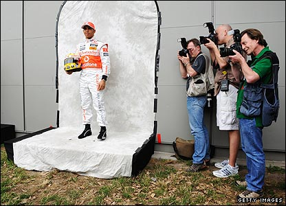 Lewis Hamilton poses for phorographers