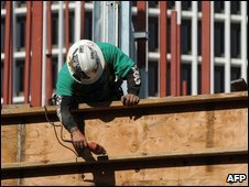 A construction worker on a new residential and commerical building construction site in Los Angeles