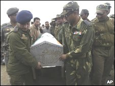 Indian army and police officers carry the coffin of Shabir Ahmed Malik