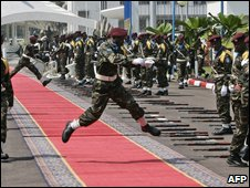 Congolese soldiers jump over the red carpet before the arrival of Nicolas Sarkozy in Kinshasa on 26 March 2009