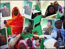 Women hold pictures of Col Gaddafi in Mauritanian capital Nouakchott on 10 March 2009