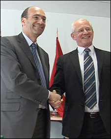French minister Eric Woerth and Allan Bell