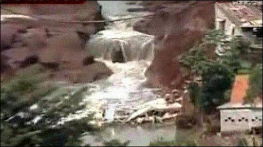 Burst dam in Indonesia